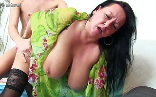 Beamy breasted mam going to bed added to sucking youngsters
