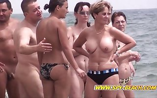 Shut cam on the top of a Spanish nudist seaside